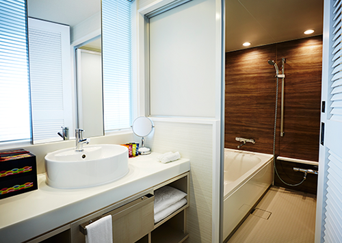 Images of the bathroom with washing space & standalone toilet